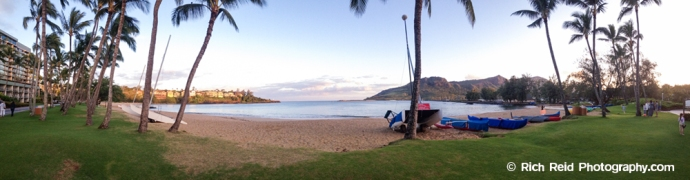 Panorama of the palm-lined Kalapaki Beach in Nawiliwili Harbor on Kauai, Hawaii.