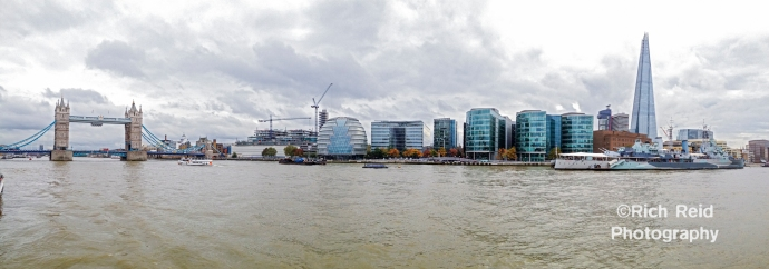 Panorama from a boat on the Thames River of the Tower Bridge and Shard in London, UK.
