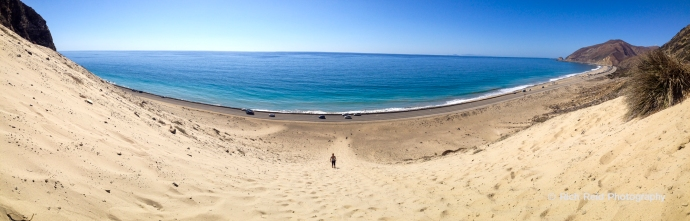 Panorama of sand dunes and the Pacific Coast Highway near Malibu, California.