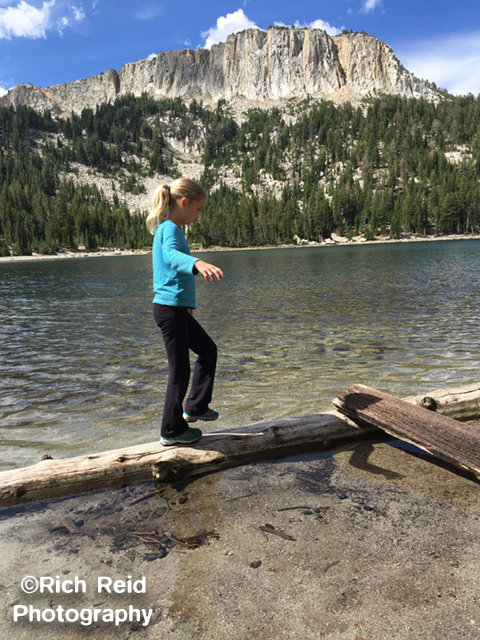 KNOT SAFE. Walking the log at McCloud Lake at Mammoth Lakes, California.
